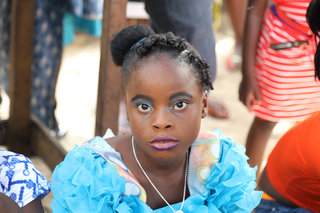 Aliya Naumoff  - Liberia, West Africa - Girl_Dressed_Up_to_Sell